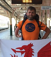 mum and sister stood proudly with Welsh flags at the train station of Aberystwyth to surprise me with a warm welcome back